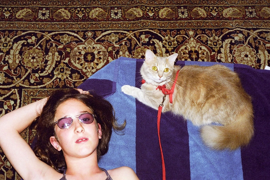 Léa And Her Cat, Beach Scene, 2001, Analogue Photo, 35mm Format © Anne-Lena Michel