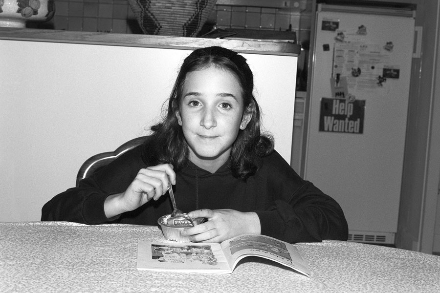 "Léa, Eating Her ""goûter"", 2001, Analogue Photo, 35mm Format © Anne-Lena Michel"
